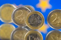 Euro coins on a blue background stock photo
