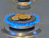 Euro Coins In Blue Flames From Burner Royalty Free Stock Photo