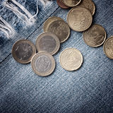 Euro coins on blue jeans background Royalty Free Stock Photography