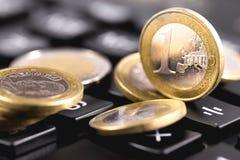 Euro coins. On a calculator stock image