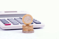 Euro coins and calculator stock image