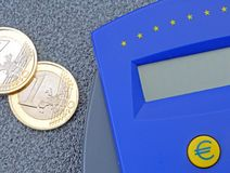 Euro coins with calculator Royalty Free Stock Photos