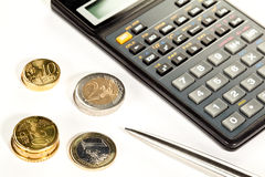 Euro coins, calculator and a pen. Increment of capital: euro coins, calculator and a pen Stock Photo