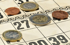 Euro coins on the cards for Russian lotto game. Royalty Free Stock Photography