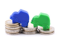 Euro coins and cars. Euro coins and small blue and green cars royalty free stock photos