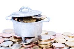 Euro coins in cauldron Royalty Free Stock Photography