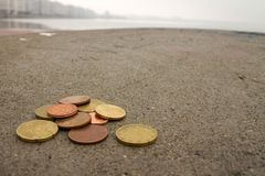 Euro coins on the cement floor royalty free stock photography
