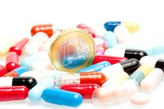 Euro coins in the center of medical pills Stock Photography