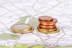 Euro Coins with Touristic Travel Map. Euro coins with city map background in touristic travel and finance concept Royalty Free Stock Photos