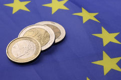 Euro coins. Currency of the European union over flag stock photos