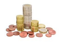 Euro coins different denominations partially stacked in columns Stock Photo