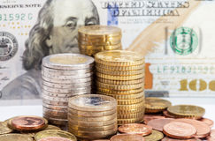 Euro coins on dollars  background Royalty Free Stock Images