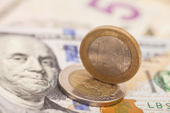 Euro Coins And Dollars Stock Image