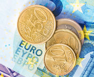 Euro coins on euro banknotes background Royalty Free Stock Photography
