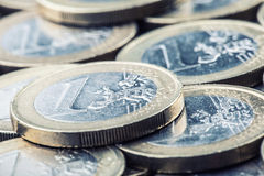 Euro coins. Euro money. Euro currency.Coins stacked on each other in different positions. Money concept royalty free stock photos