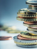 Euro coins. Euro money. Euro currency.Coins stacked on each other in different positions. Stock Images