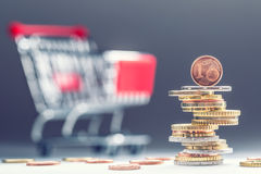 Euro coins. Euro money. Euro currency.Coins stacked on each other in different positions. Money concept. Shopping trolley. Shopping cart Stock Photography