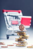 Euro coins. Euro money. Euro currency.Coins stacked on each other in different positions. Money concept. Shopping trolley. Shopping cart Stock Photo