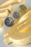 Euro-Coins on a Euro-Sign. Euro-coins on a golden Euro-sign Royalty Free Stock Photos