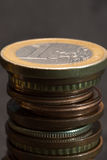 Euro coins. Euro and eurocents stacked. One euro on top Stock Photos