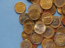 Euro coins, European Union over blue with copy space Royalty Free Stock Photography
