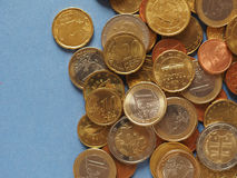 Euro coins, European Union over blue with copy space Royalty Free Stock Photos
