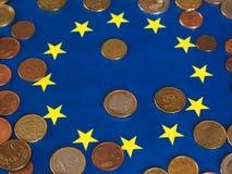 Euro coins, European Union, over flag Royalty Free Stock Photography