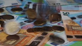 Euro coins falling stock video footage
