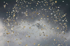 Euro coins falling in the sky. Euro coins falling in a cloudy sky Royalty Free Stock Photo
