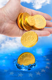 Euro coins falling to the water. Royalty Free Stock Photography