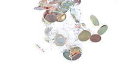 Euro coins falling into the water royalty free stock photos