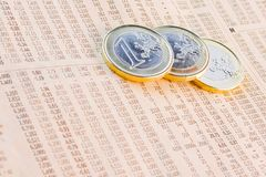 Euro coins on the financial newspaper stock photos