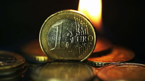 Euro coins on fire stock footage