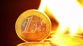Euro coins on fire stock video