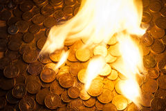 Euro coins on fire Royalty Free Stock Photography