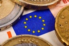 Euro coins and flag Stock Photos