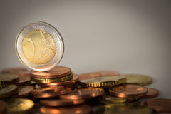 Euro coins. 2 euro in foreground stock photography