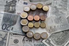 Euro coins in the form of a euro sign royalty free stock photo
