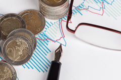 Euro coins and fountain pen Stock Photo