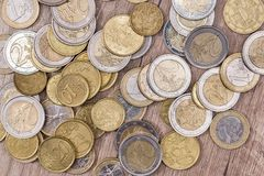 Euro coins in group. On a wooden desk stock images