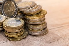 Euro coins in group. On a wooden desk royalty free stock images