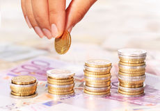 Euro coins and hand Royalty Free Stock Photography
