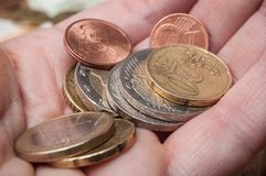 Euro coins in hand. Closeup of euro coins in hand Royalty Free Stock Photo