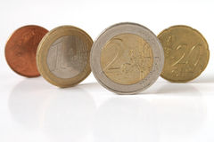 Euro coins isolated. Euro coins standing and isolated over white background