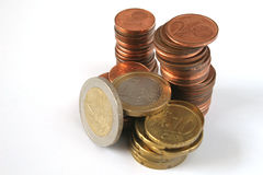 Euro coins isolated. Euro coins in piles isolated over white background