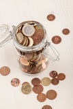 Euro coins in jar Royalty Free Stock Photos