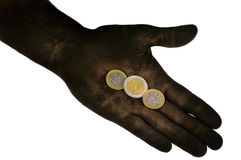 Euro coins lying on dirty hand. Isolated on white. Concept photo stock image