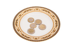 Euro coins lying on plate Stock Photos