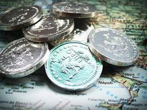 Euro Coins on Map Royalty Free Stock Image