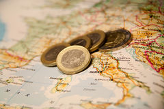 Euro coins on a map of italia. An europe Royalty Free Stock Photos